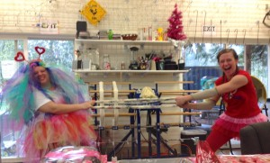 Aimee and Kalia doing some skein aerobics. Don't worry it's a mill-end all skeins are treated with love and kindness!